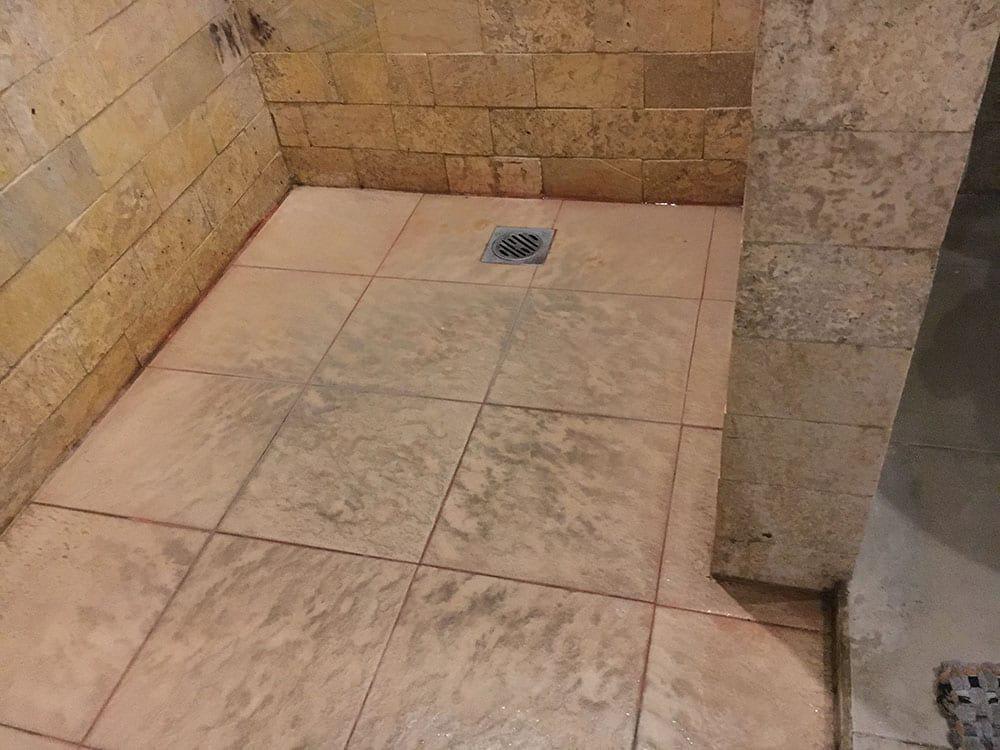 Pink mould on shower floor
