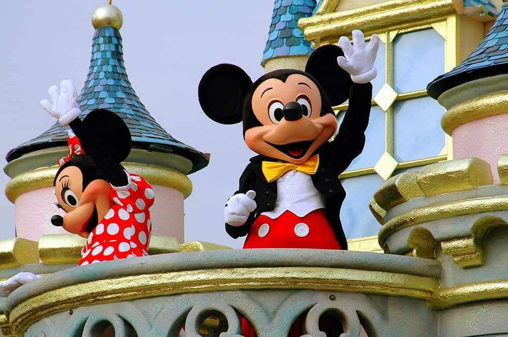 Minnie and Mickey Mouse waving