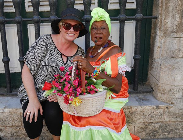 Megan and Cuban lady posing for photo